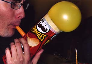 [Instrument made of a Pringles tube and a balloon.]